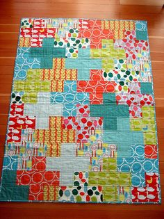 """Love it. Creator's explanation of the design: """"this is a dot-dot-dash pattern, where you sew blocks (in short-short-long sizes) into rows and then sew the rows together. it's quite easy to see once you sketch it out on paper. my finished """"squares"""" are each 4x4, so i cut pieces to 4 1/2 x 4 1/2, 12 1/2 x 4 1/2, and a few 8 1/2 x 4 1/2 for the side pieces where the crosses get cut off."""""""