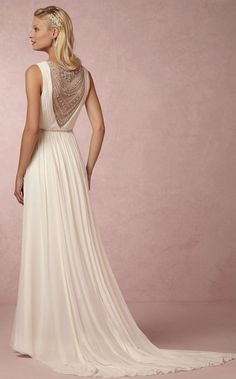 Chic vintage inspired white wedding dress with intricate back design; Featured Dress: BHLDN