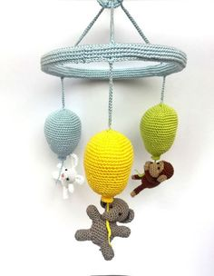 This wonderful crib mobile is perfect for your baby's nursery! It features 3 colorful crocheted balloons and 3 cute animals who will catch your baby's attention. This balloon mobile is totally handmad Crochet Baby Mobiles, Crochet Mobile, Crochet Baby Toys, Crochet Sloth, Crochet Animals, Baby Crib Mobile, Handmade Baby, New Baby Gifts, Crochet Projects
