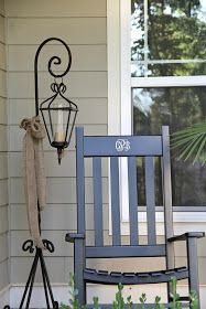 Adding monogram to rocking chairs on the front porch. Yes! I like the hanging lantern with a burlap bow, too!