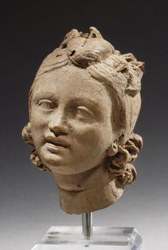 HELLENISTIC GREEK HEAD OF A YOUNG GIRL:       DATE:  2nd Century BC   CULTURE:  Greek, Hellenistic Greek  CATEGORY:  Sculpture  MEDIUM:  Terracotta #ancient art #art