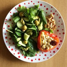 Today's yumminess is the @fitgirlsguide #saladenicoiseredux  my other half doesn't like tuna so I stuffed the peppers with cous cous sundried tomatoes and feta with a side of cashew nuts almond stuffed olives avocado slices cucumber and spinach. A perfect balance of carbs protein & healthy fats!