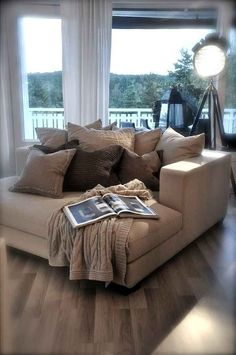 The couch that is so deep that you could pile one hundred pillows on it and still have space to flop down and read a magazine. | 30 Impossibly Cozy Places You Could Die Happy In