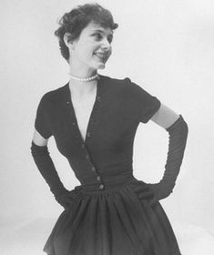 1948    Postwar, the fashion world took a new turn with Christian Dior's legendary New Look: wasp waist, lavishly full skirt, as with this knocked-off version