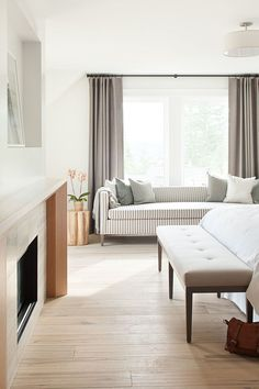 Love the sofa for reading in this master bedroom