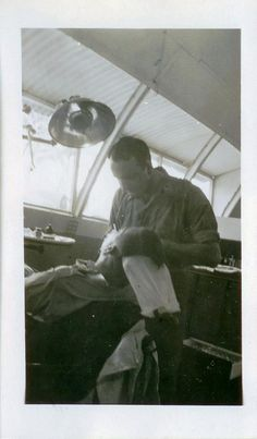 This is a photo of my dad (undated) taken at the US Navy South Pacific Base in New Guinea during WWII. My dad is doing dental work on the Navy Chaplain. He opened his practice here in Lafayette in 1940. He joined the Navy in 1942 and served in the North Africa and the South Pacific. He attained the rank of Leutinant Commander and was honorably discharged from the Navy in 1946 and resumed his Dental practice. He retired from Dentistry in 1984.