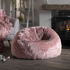 Sumptuous pink faux fur bean bag chair is an excellent addition to your home decor. Perfect for pink interiors, girls bedrooms and a glamorous seat for your guests this season.