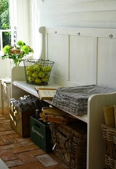 Cottage Entrance Bench & Storage ... we have a church pew in our entry way. i like the idea of attractive bins underneath.
