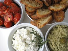 These three crostini toppings, artichoke-olive dip, ricotta cheese, and roasted cherry tomatoes, have become a favorite of mine for dinner parties.