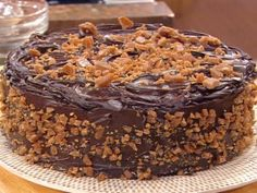 Cooking Channel serves up this Sour Cream Toffee Fudge Cake recipe from Emeril Lagasse plus many other recipes at CookingChannelTV.com