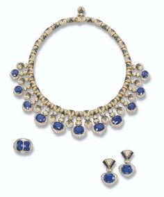 PROPERTY OF A ROYAL HOUSE: A SAPPHIRE AND DIAMOND SUITE, BY BULGARI The necklace designed as a graduated fringe of eleven oval-shaped sapphires within a domed pavé-set diamond heart-shaped surround to the domed pavé-set diamond and buff-top sapphire spacers and links, ear pendants and ring en suite.