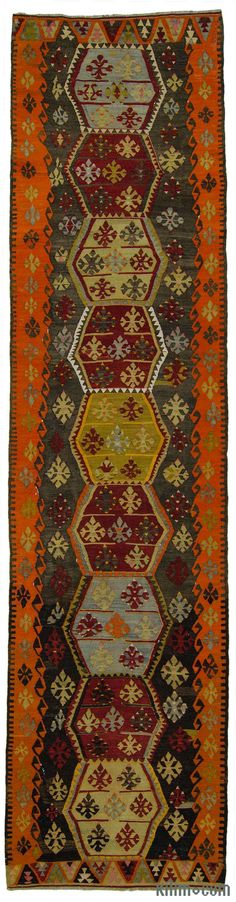 Beautiful vintage tribal Turkish kilim runner rug around 70 years old and in very good condition. This long kilim runner was hand-woven in the Sivas region of Central Anatolia, Turkey.