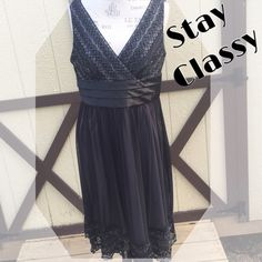Black Formal Dress Beautiful black, gray and silver dress. Detailing on bottom hem. Tulle like skirt with gray lining. V neck with wide black band at waist. Pre loved. From shoulder hem to bottom is roughly 40 inches. Width where black band is measures about 38 inches. Top has a little stretch to it but not much stretch in band. R&M Richards Dresses
