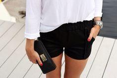 Black shorts, white blouse