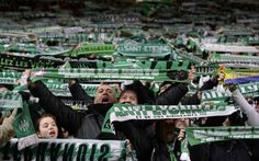Saint-Etienne's supporters wave scarfs to show support to their team during the French L1 football match between Saint-Etienne and Marseille, at the Geoffroy Guichard stadium in Saint-Etienne, central France, on February 16, 2014.