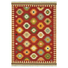 Add stylish touch to your living room or den with this hand-woven wool rug, showcasing a Turkish kilim-inspired motif.   Product: Ru...