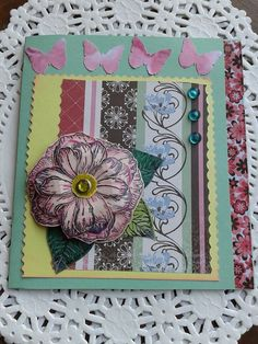 Femenine card...stamped flower..center brad..color dots..form scissors...punched butterflies...strip of floral ribbon...