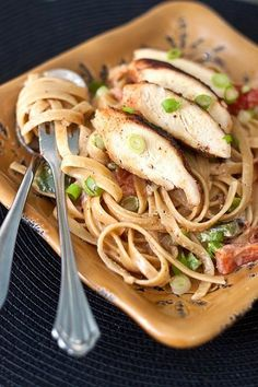 Cajun Chicken Pasta..........It's got a ton of flavor, and a good kick of heat. But, not too much – the boys are both able to enjoy it.