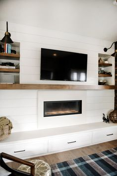 shiplap and modern fireplace with floating wood mantel, concrete surround and hearth