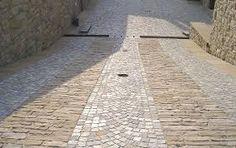 Risultati immagini per pavimento esterno porfido moderno