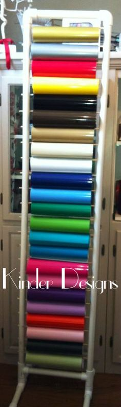 DIY vinyl storage with 1 pvc pipe . What a great idea for storing your vinyl fabric. It takes up little space and can sit right by the cutter to save steps! That is a lot of vinyl! Diy Vinyl Storage, Craft Room Storage, Paper Storage, Craft Organization, Storage Ideas, Ribbon Storage, Storage Rack, Fabric Storage, Storage Organizers