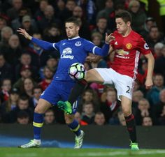 Ander Herrera of Manchester United in action with Kevin Mirallas of Everton during the Premier League match between Manchester United and Everton at...