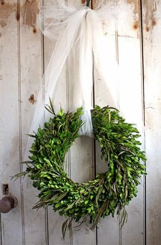 Beautifully simple boxwood Christmas wreath ... I love it