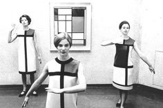 The three famous Mondriaan-dresses by Yves Saint Laurent, 1965. In front of a Mondriaan painting.