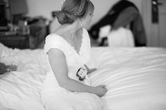 Candid black and white photo of the bride as she chats to her bridesmaids.   Wedding Photography The Shelbourne Hotel