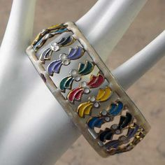 Colorful Bohemian Rainbow bangle in a small size This brightly enameled Indian bangle has red yellow blue brown purple green white and cream colors,