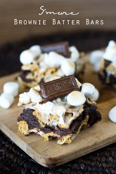 S'more Brownie Batter Bars on MyRecipeMagic.com. Gooey bars with brownie batter sandwiched between marshmallow covered Golden Grahams and toasted marshmallows on top!