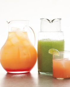 Mojito Slushie (1/2 cup sugar  1/2 cup water  10 cups crushed ice  1/3 cup lemon juice   1/3 cup lime juice  1 cup white rum  1 cup fresh mint leaves)