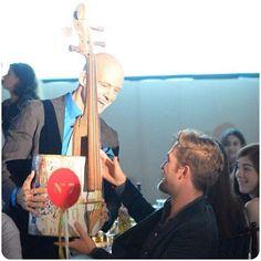 Rob with his winning bid, recycled cello at the Go Go Charity Gala #gogogala2013 #robertpattinson