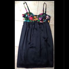 Single Floral Black Silk Party Dress Size Small Single brand 100% silk dress. Zips up back. Adjustable shoulder straps. Size small. Built in cups for nice shape. Worn a couple of times. Single Dresses