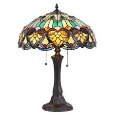 Light up your world with an enchanting rainbow of color and light when you add this gorgeous Tiffany-style table lamp to your space. Featuring hand-cut stained glass and resting atop a rich copper bas