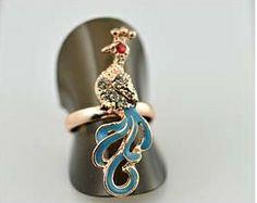 Bague paon disponible en 4 coloris en vente ici http://www.pyramideauxbijoux.com/bijoux/bagues-4/2