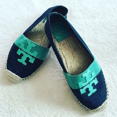Tory Burch logo canvas espadrille In great condition as this has been worn no more than 5 times. I'm more of a heels type of girl, so I rarely ever wear flats. Trying to downsize. Super cute turquoise color with the Tory Burch logo. Size 5. I'm actually a size 6 but these fit me - I usually buy a size smaller when it comes to Tory Burch. **Join Poshmark app with my code HPYGO and get $10 to spend!** Tory Burch Shoes Espadrilles