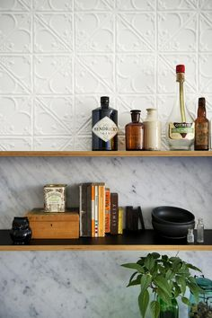 Klopper & Davis Architects Pressed tin wall, marble splashback and timber shelving