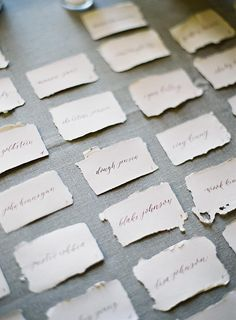 Calligraphied place cards on handmade paper.