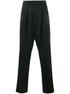 Купить Haider Ackermann stripe track pants.