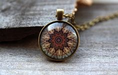 Handmade mandala pendant on a chain or a leather cord. Nice looking sacred geometry necklace for people who like religious jewelry. Lovely 1 inch