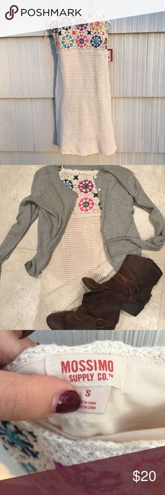 Beautiful crocheted dress new with tags This is a beautiful crochet dress. New with tags, in a size small. Made of 100% Cotten and liner 100% polyester. Perfect for the summer, spring or fall with a nice cardigan. Mossimo Supply Co Dresses