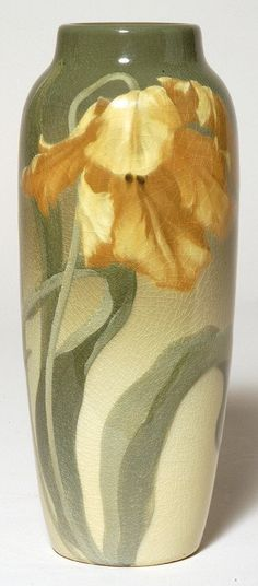 "Exceptional Rookwood Iris glaze vase with life-like flower decoration that encircles the vase by Fred Rothenbusch.  Background shades from green to gray to white.  Dated 1903.  Shape #907D.  Artist's initials are incised.  Light overall crazing.  Height 10 5/8"".  Acquired from the Ed Kircher collection and pictured in his 1969 book titled Rookwood It's Golden Era of Art Pottery 1880-1929."