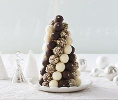 Chocolate Truffle Christmas Tree: Make an impressive addition to your Xmas table with this delicious Truffle Tree – a variety of truffles are sure to please one and all!. http://www.bakers-corner.com.au/recipes/desserts/chocolate-truffle-christmas-tree/