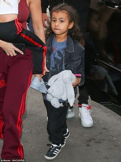 Fuzzy friend: North, the daughter of Kim Kardashian and rapper/designer Kanye West, wore a denim jacket over a blue tee-shirt and carried a plush friend Kim Kardashian And North, Kardashian Family, Kardashian Style, Kardashian Jenner, Kourtney Kardashian, Kardashian Fashion, Little Kid Fashion, Kids Fashion, Fashion Ideas
