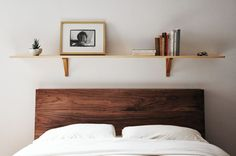 I love the look of this shelf above the bed. I have been trying to figure out what to do above our bed. Maybe even put in three stacked shelfs to add height. Versatile Bedroom Decor: Shelves Above the Bed Shelf Above Bed, Headboard With Shelves, Bed Shelves, Shelves In Bedroom, Storage Headboard, Shelving Above Bed, Headboard Ideas, Bed Backboard, Diy Shelving