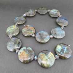An 18k white gold labradorite strand with large labradorite disks and small labradorite rondelle beads. Designed and made by llyn strong.