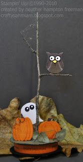 """Owl on a tree with pumpkins and ghost. Made with the following punches - Two Step Owl Extra Large - for owl and ghost, Butterfly Extra Large- for pumpkin vine leaves; (trim the lower portion of the wing off to create the leaves, or they could easily be cut freehand), Small Oval - for pumpkin, 1"""" Circle - for pumpkin."""