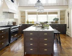 House Beautiful - kitchens - Benjamin Moore - Navajo White - white upper cabinets dark lower cabinets, dark brown cabinets, dark brown kitch...