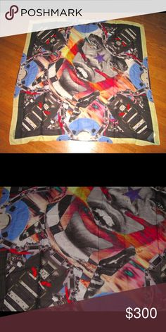 """GIVENCHY PARIS SUNSET TRIBAL FACE 17 SCARF Robot Up for sale is the super amazing Givenchy Sunset Tribal Face scarf. It is new and never worn. The print is amazing with all kinds of details to it. It measures about 46"""" square, and is a cotton / modal blend. Givenchy Accessories Scarves & Wraps"""